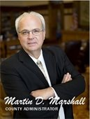 Marty Marshall; arms crossed